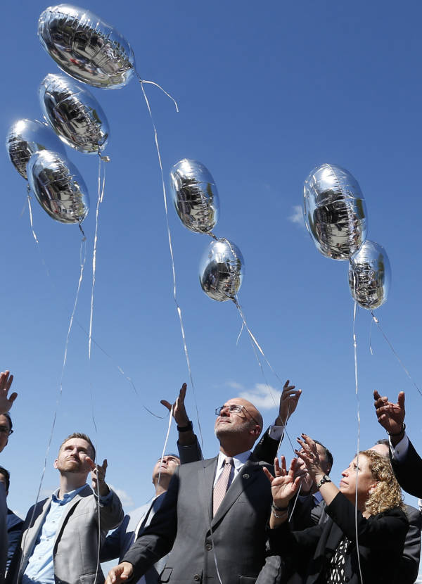 People Releasing Balloons