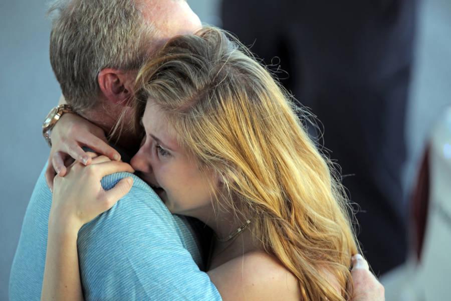 Woman Crying Hugging