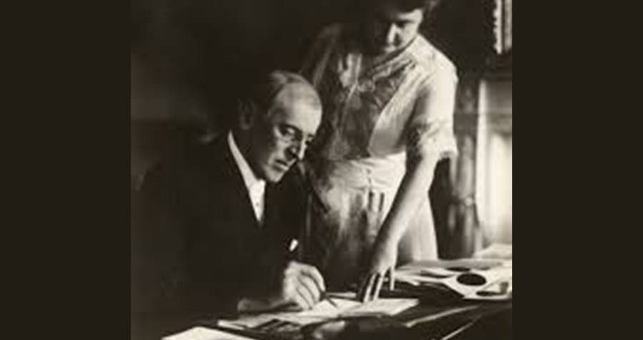 Edith And Woodrow Wilson Signing A Document