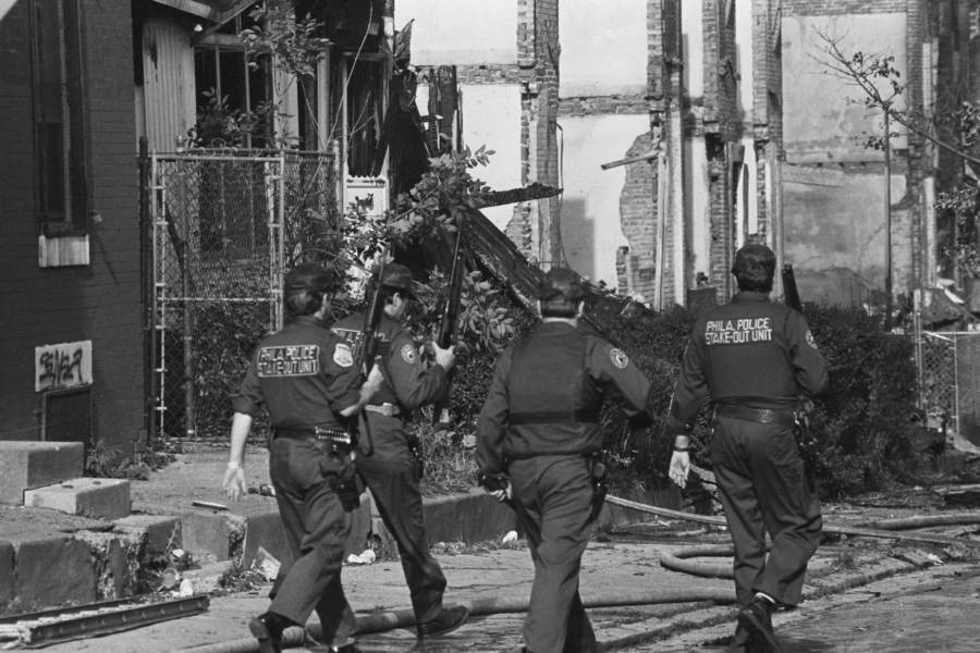 Police Walk Through Rubble