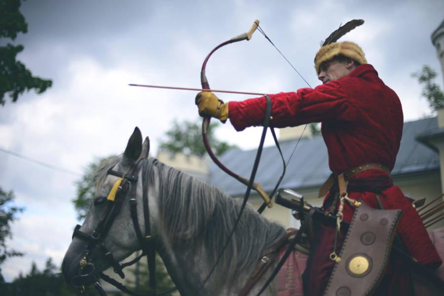 Man Firing Bow And Arrow