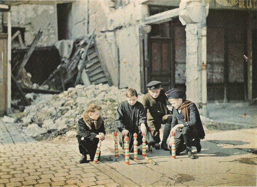 Children Bowling Amid Ruins