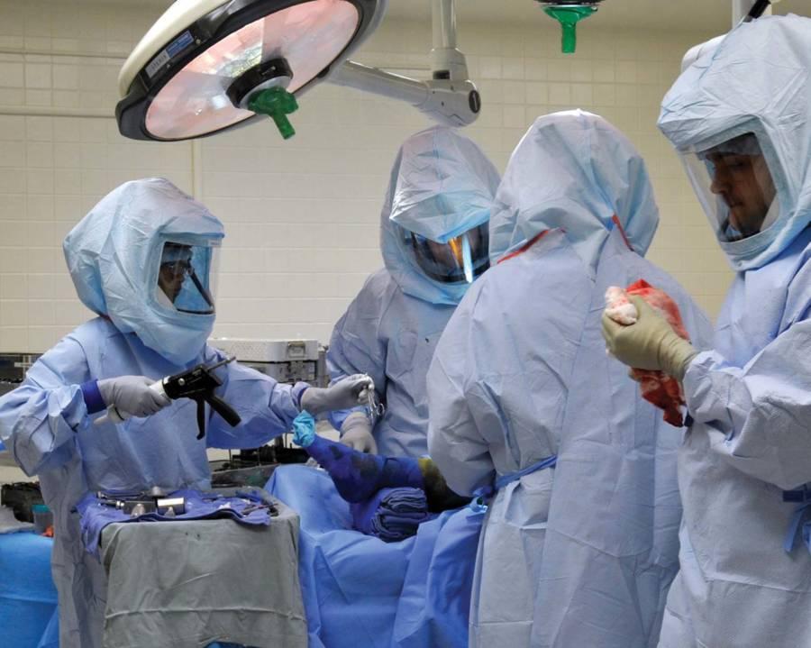 Doctors Working In Hazmat Suits