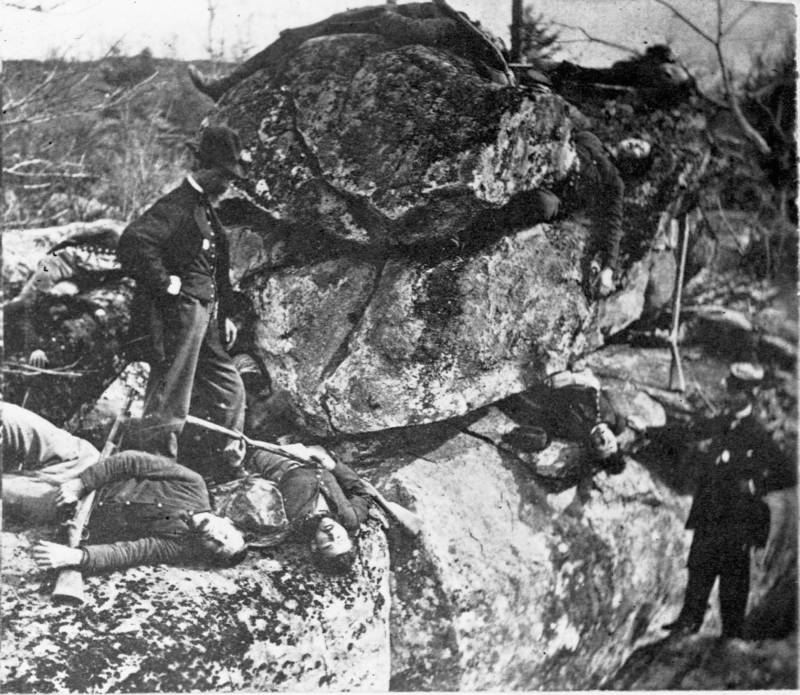 Men Examine Bodies
