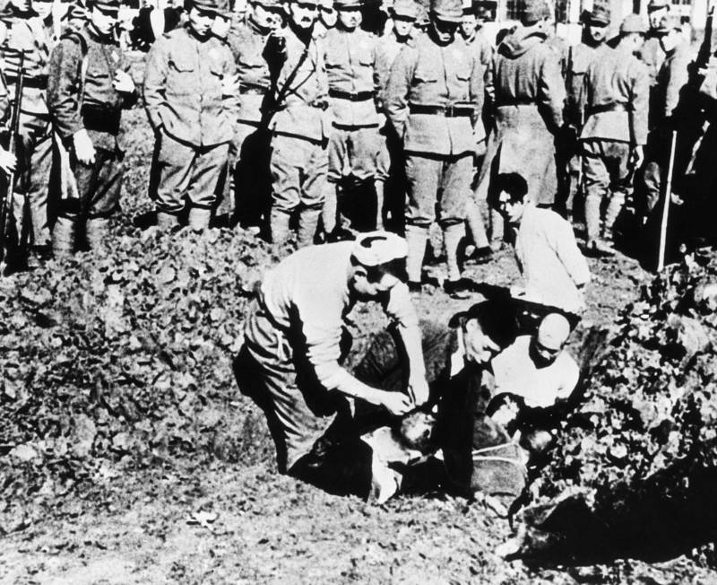 Nanking Massacre Victims Being Buried Alive