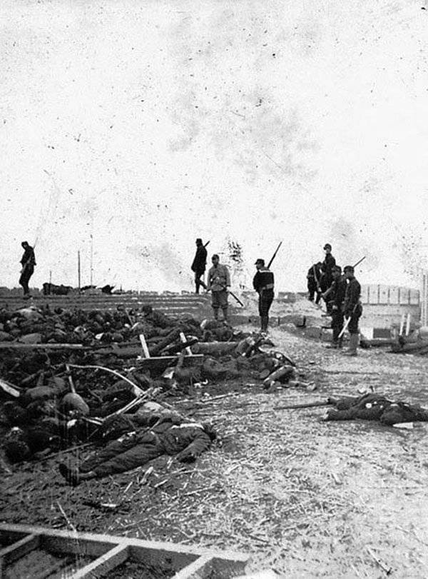 Japanese Soldiers Standing Near Bodies