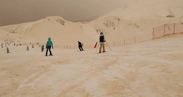 Skiers Orange Snow