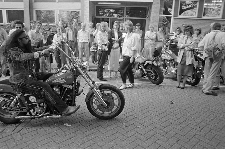 Crowd Looks At Biker