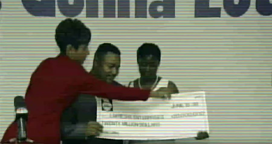 Jeffrey Dampier Being Awarded Check