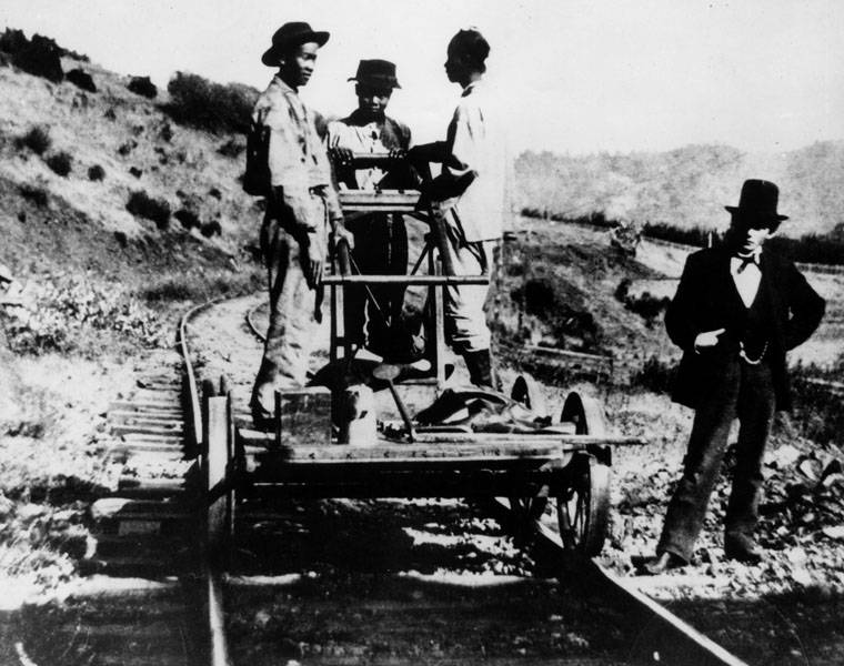 Chinese Laborers On Railroad Tracks
