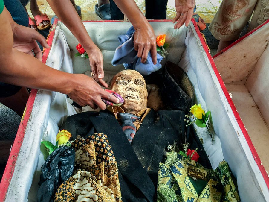 Cleaning Off Toraja Mummy