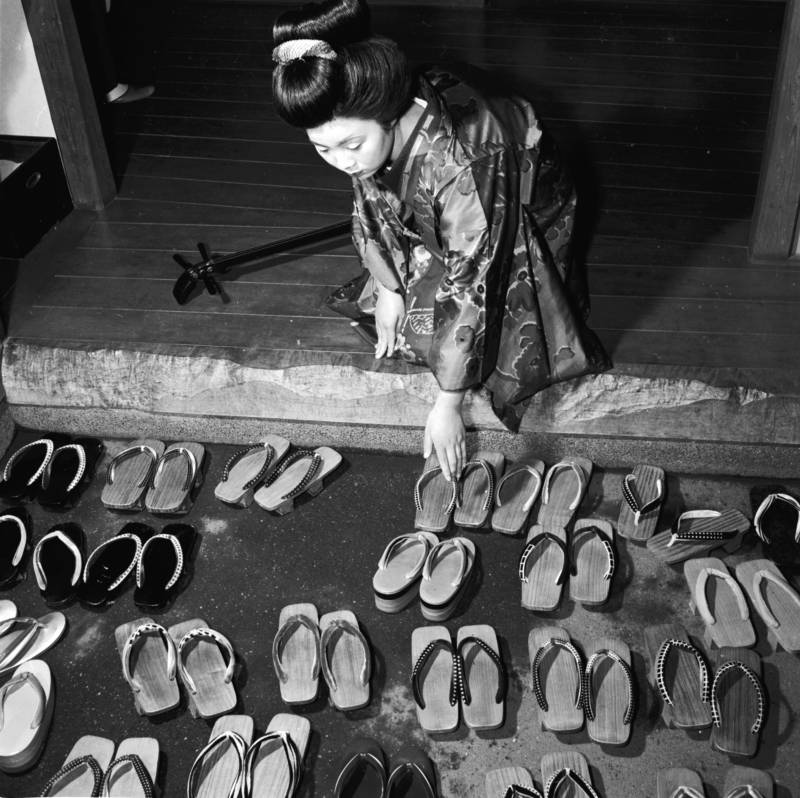 Footwear Outside Of A Teahouse