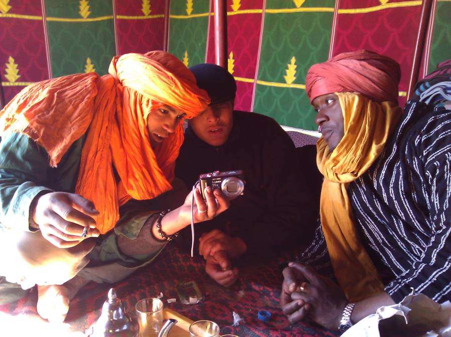 Group Of Berbers Inspecting A Camera