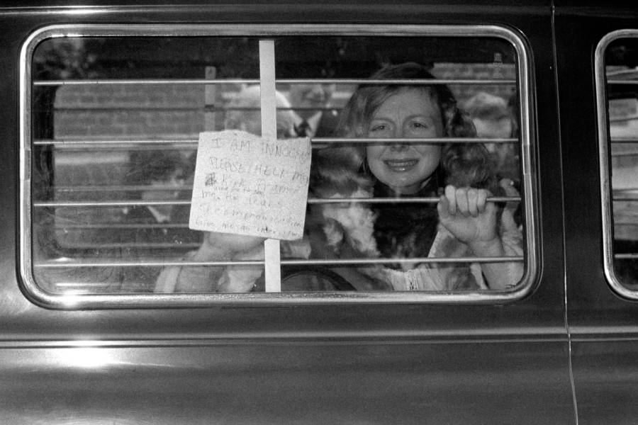 Joyce Mckinney Holding Sign
