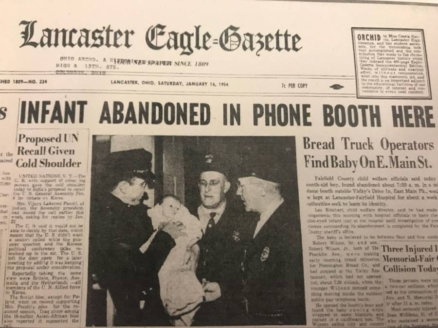 Newspaper Headline About Baby In Phone Booth