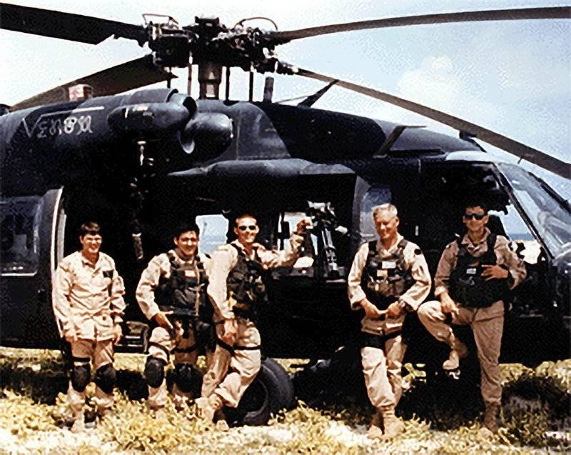 American Soldiers In Front Of A Black Hawk Helicopter