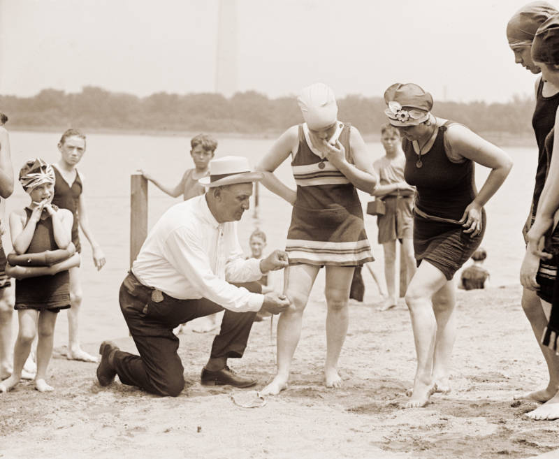 Man Measuring Flappers' Bathing Suits