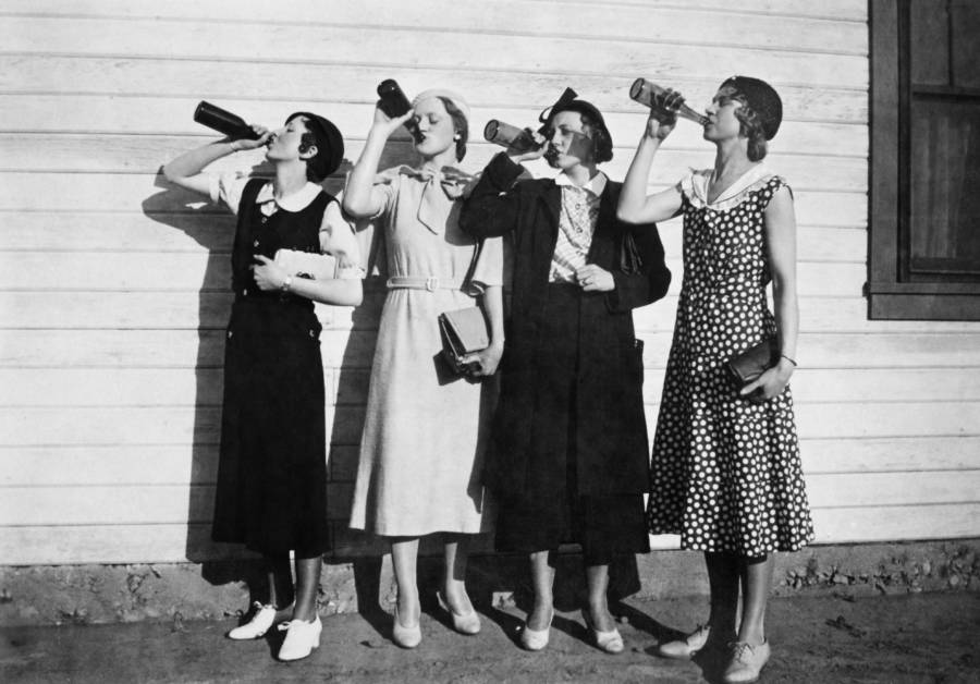 Four Flappers Drinking