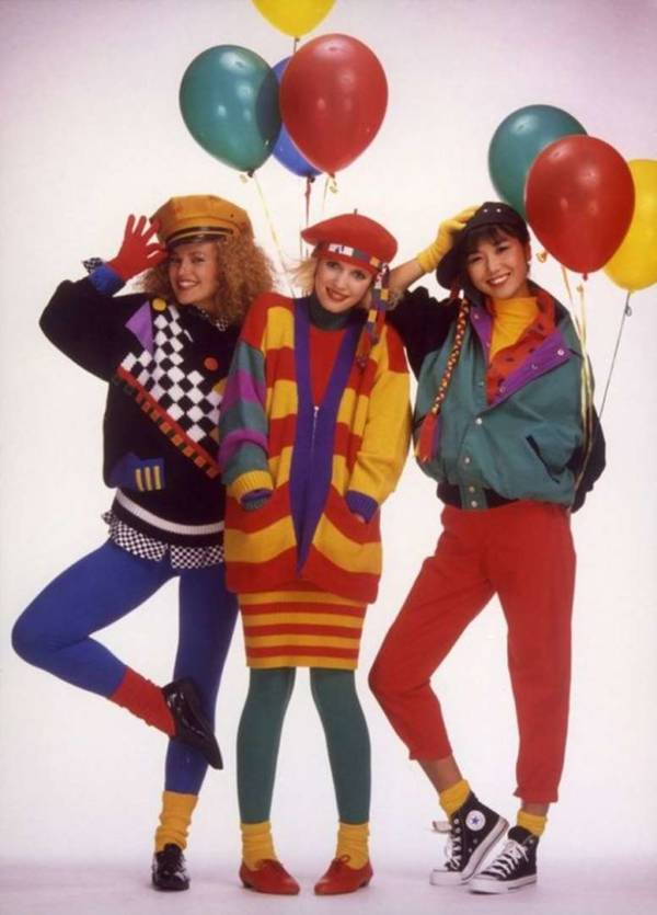 Three girls in typical 80's attire