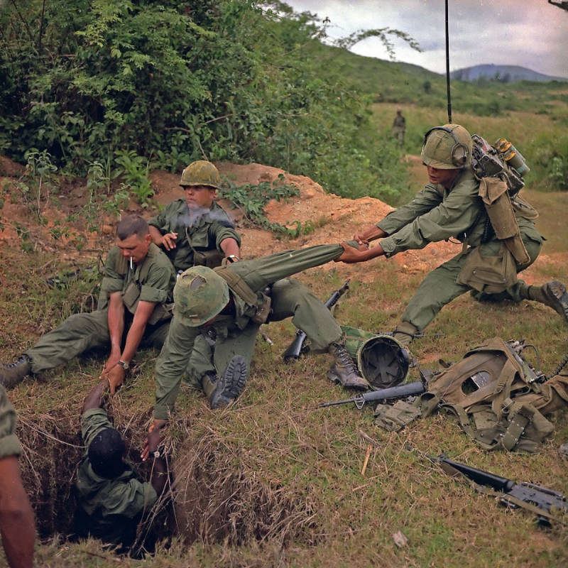 Men Reaching Into Vietcong Tunnel