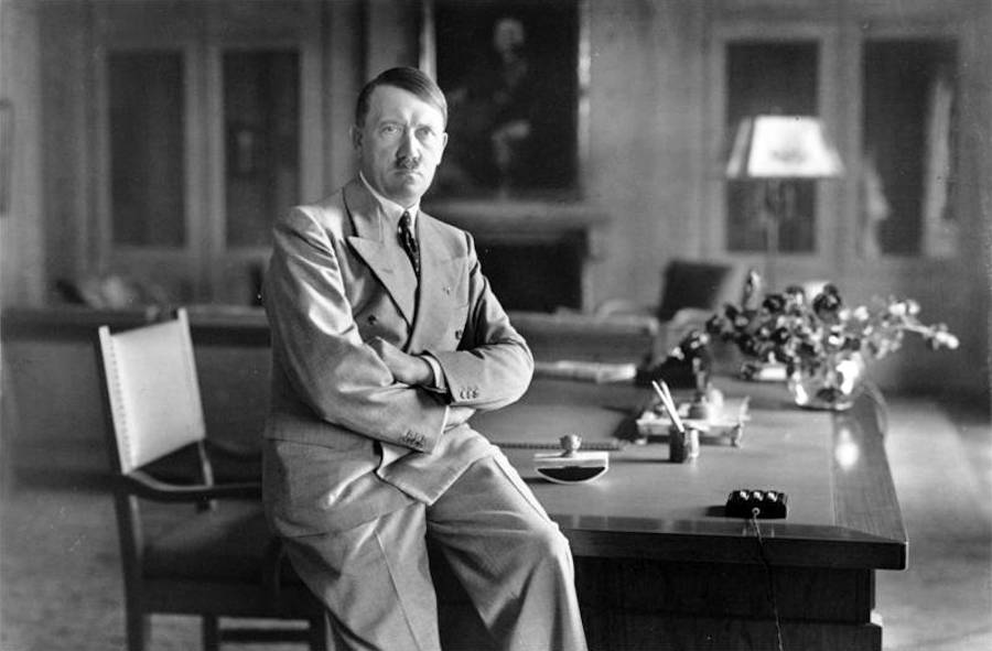 Adolf Hitler Sitting On A Table