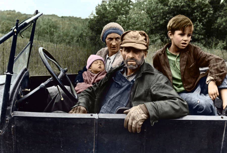 Poor Family Sitting In Car