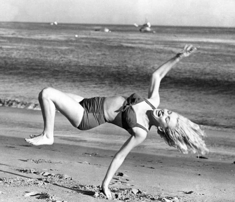 Marilyn Monroe Playing On The Beach