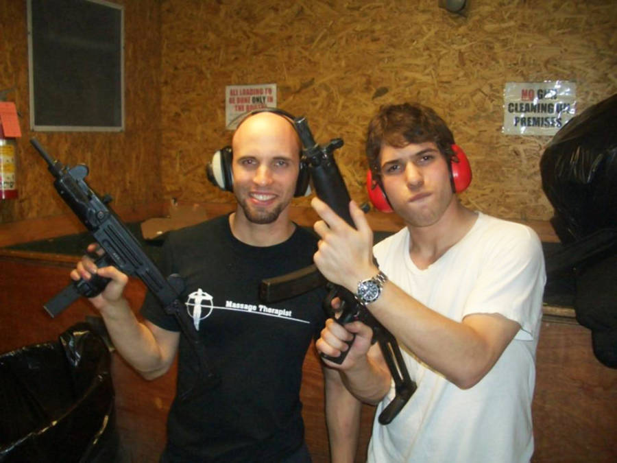 David Packouz And Ephraim Diveroli With Guns
