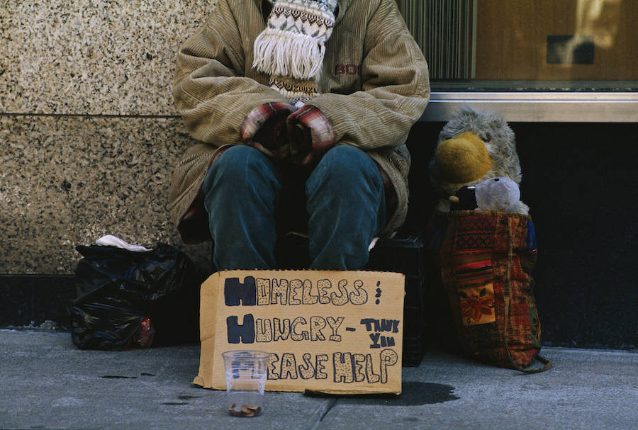 Homeless Person On Sidewalk