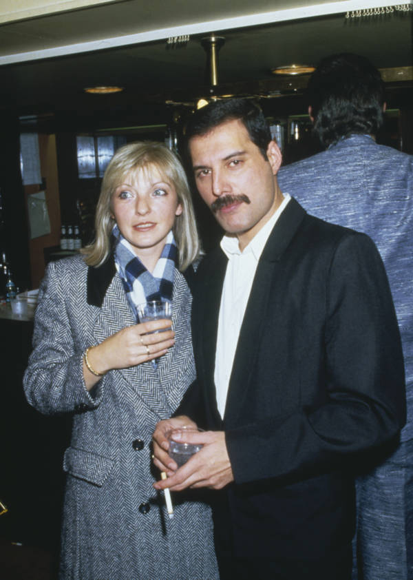 An Older Mary Austin And Freddie Mercury Pose For A Photo