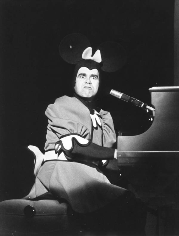 Elton John In Micky Mouse Costume At Piano