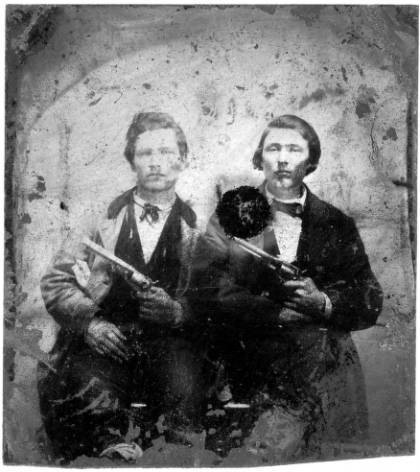 Jesse And Frank James With Guns