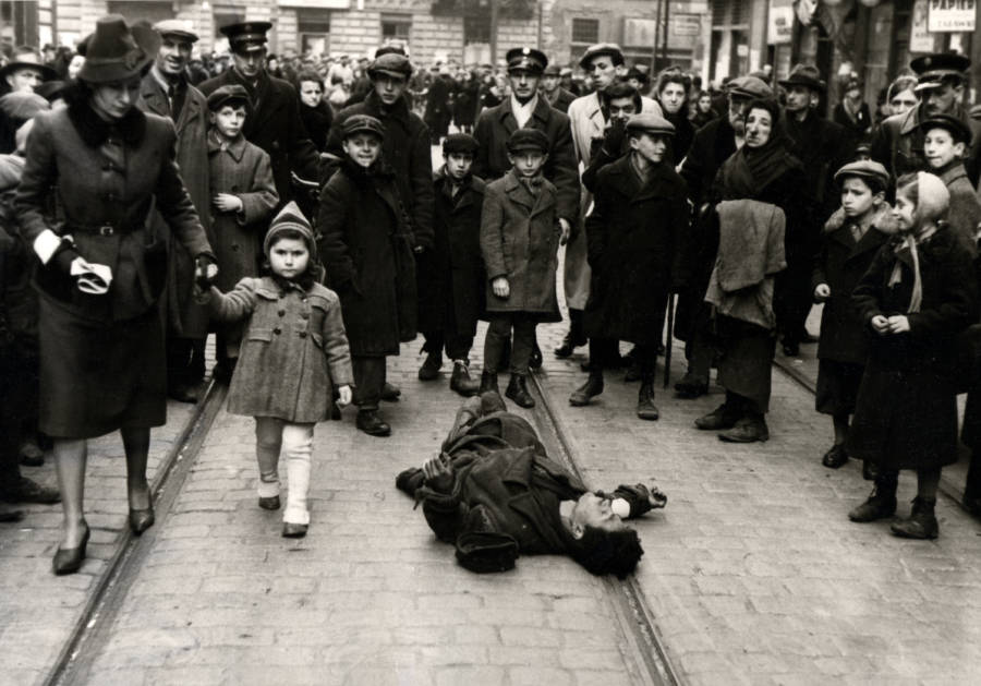 Warsaw Ghetto Passersby Ignoring Man