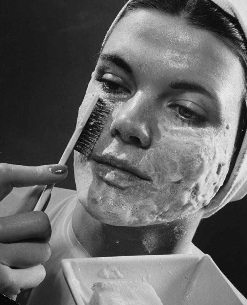 Vintage Woman Applies Cream Facial