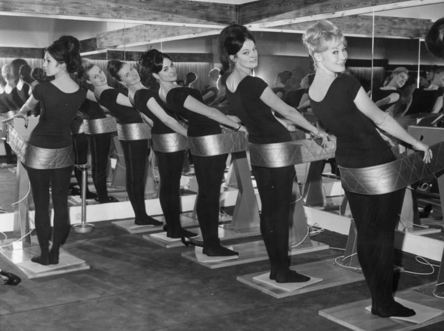 Women On Vintage Workout Machines
