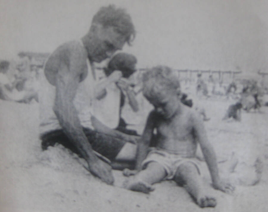 Baby Bundy In Sand With Grandpa