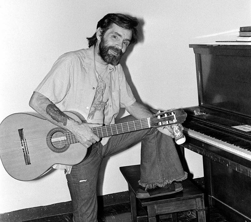 Charles Manson Playing Guitar