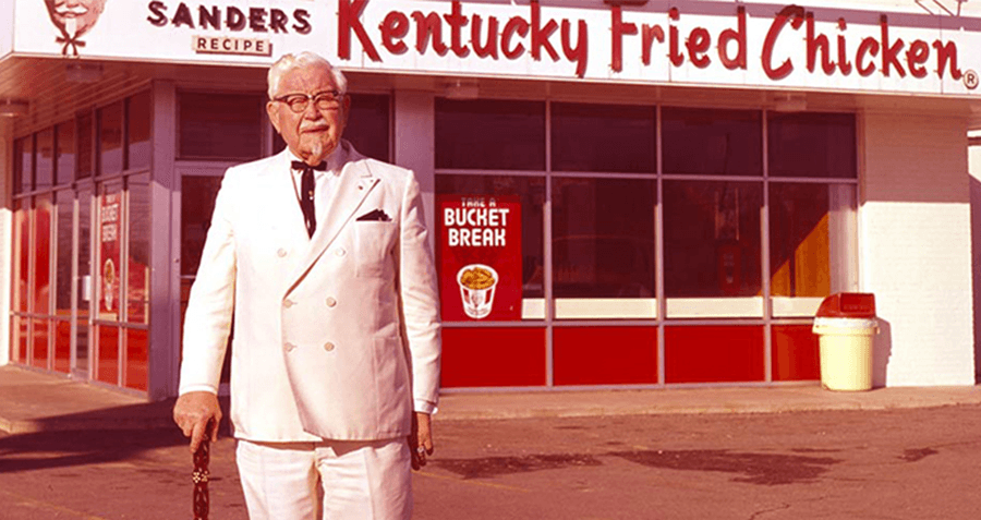 Colonel sanders in front of early kfc