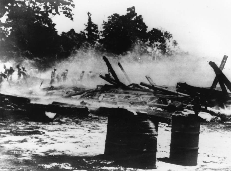 Henderson Airfield Smoulders After Japanese Attack