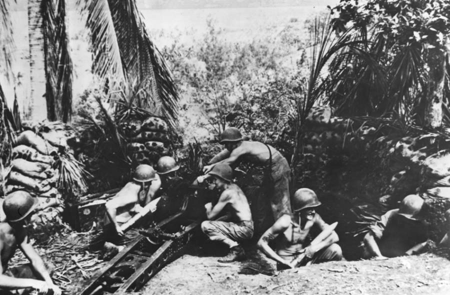 American Soldiers Man A Defensive Gun Position On Guadalcanal