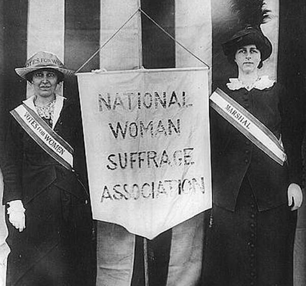 American Suffragists Beside Banner