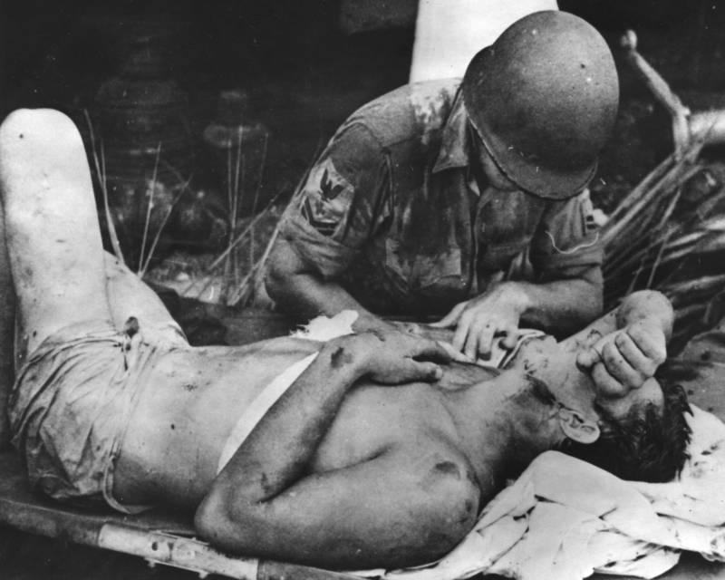 American Soldier Calms Injured Comrade At Guadalcanal