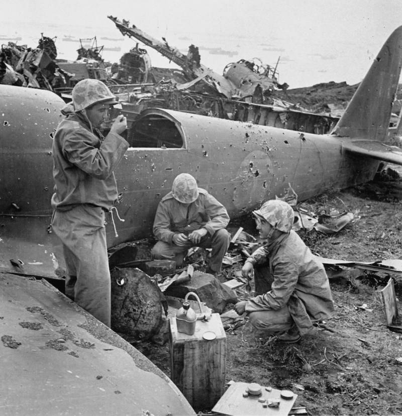 Soldiers Eat Amid Wreckage At Iwo Jima