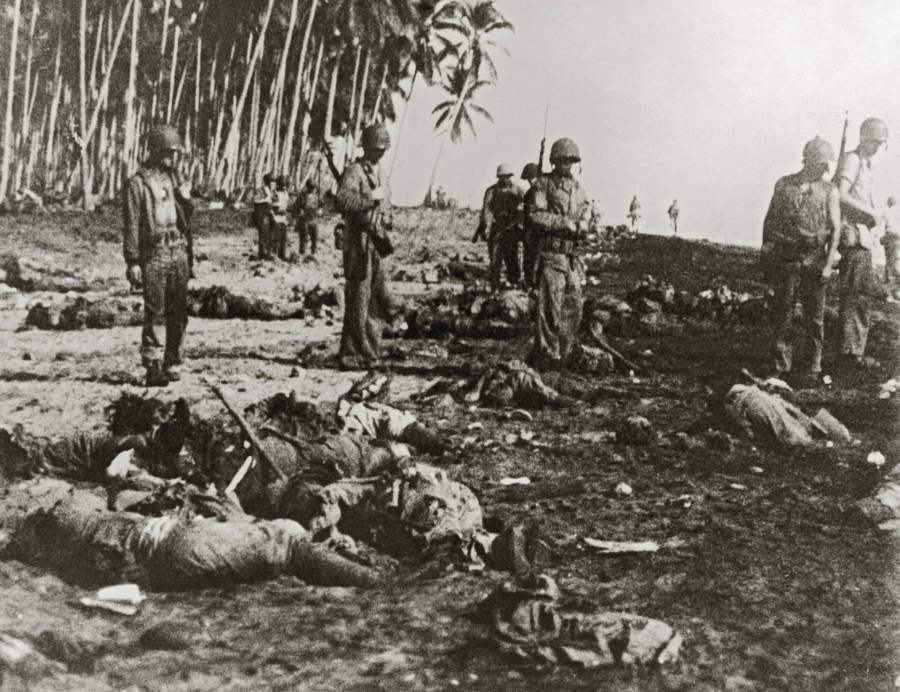 Surviving Soldiers Examine Dead Japanese Bodies At Guadalcanal