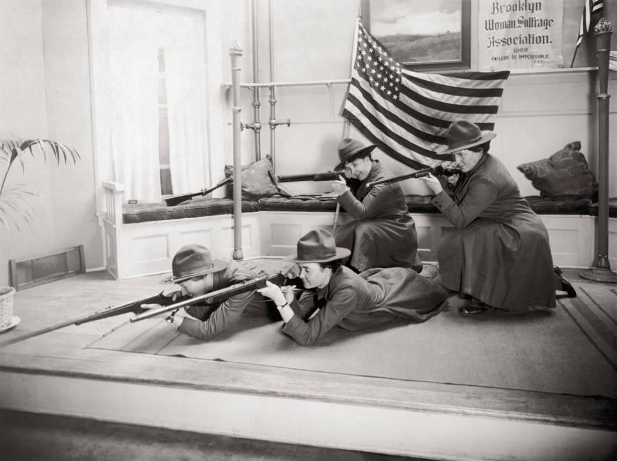 Women In Uniform Shoot Before Flag