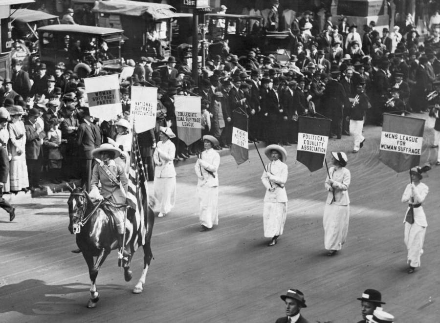 Four Women In White With Flags Lead Giant Procession