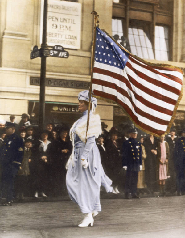 Color Woman In White Marches With American Flag