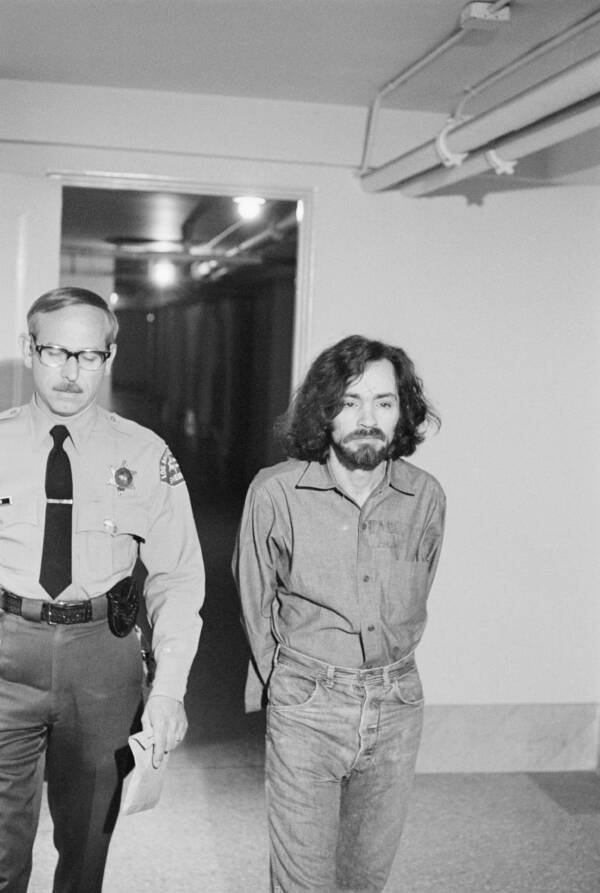 Charles Manson Escorted By Police