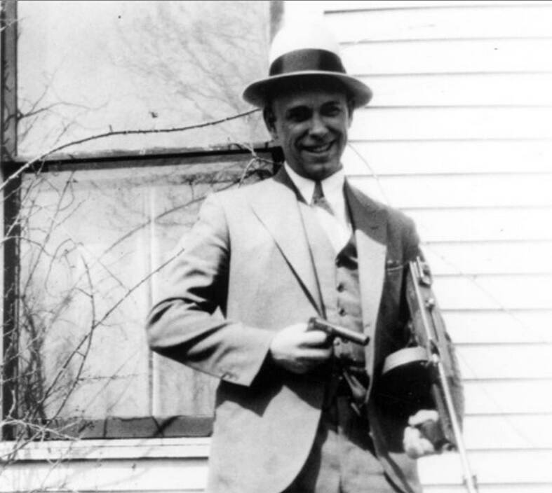 Dillinger With Machine Gun And Pistol