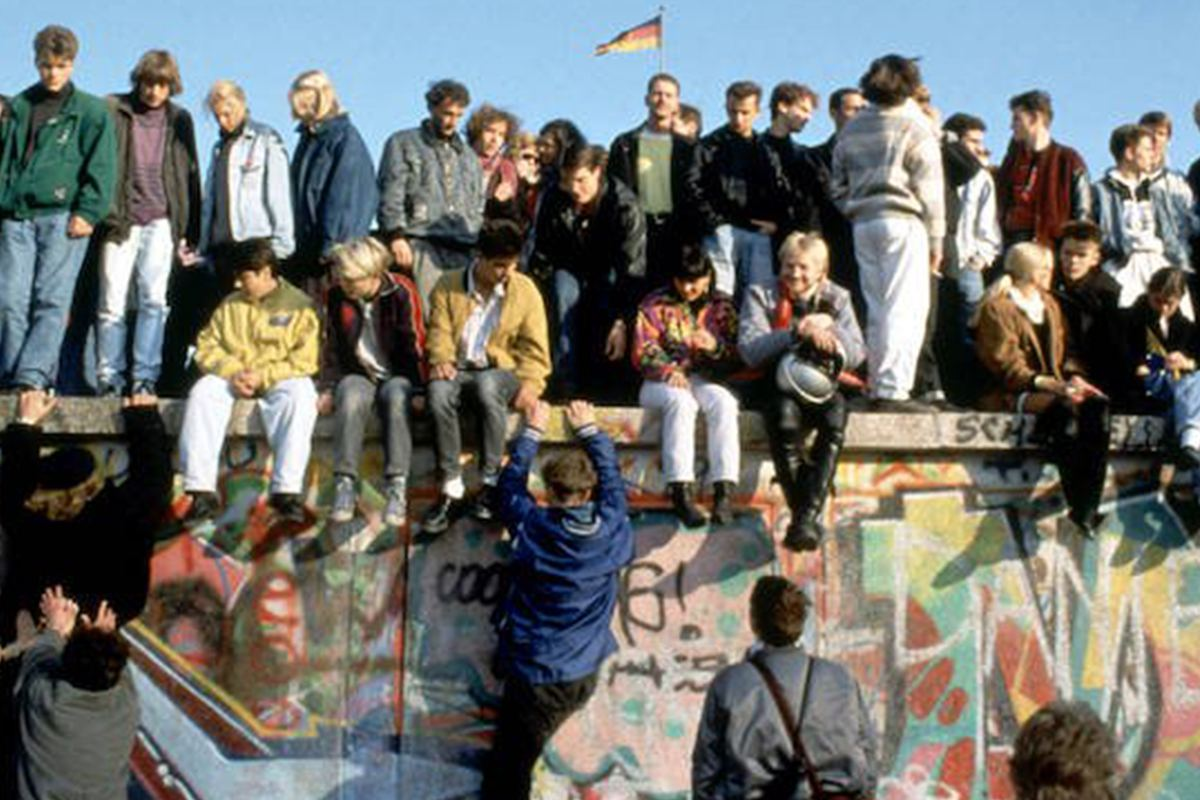 People Atop Berlin Wall Featured